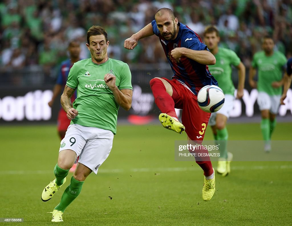 Targu Mures' Montenegran defender Sasa Balic (R) vies with Saint-Etienne's French forward <a gi-track='captionPersonalityLinkClicked' href=/galleries/search?phrase=Nolan+Roux&family=editorial&specificpeople=5969784 ng-click='$event.stopPropagation()'>Nolan Roux</a> during the UEFA Europa League third qualifying round, second leg football match between Romania's ASA 2013 Targu Mures and AS Saint-Etienne at the Geoffroy Guichard stadium in Saint-Etienne on August 6, 2015.