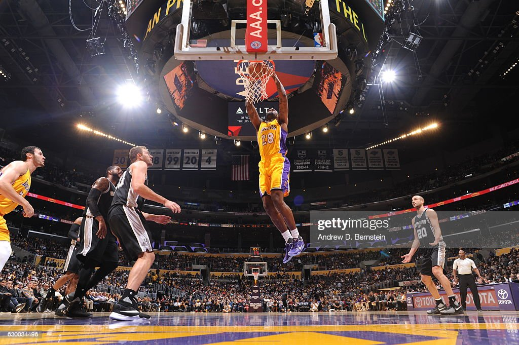 Tarik Black #28 of the Los Angeles Lakers goes up for a dunk against the San Antonio Spurs on November 18, 2016 at STAPLES Center in Los Angeles, California.