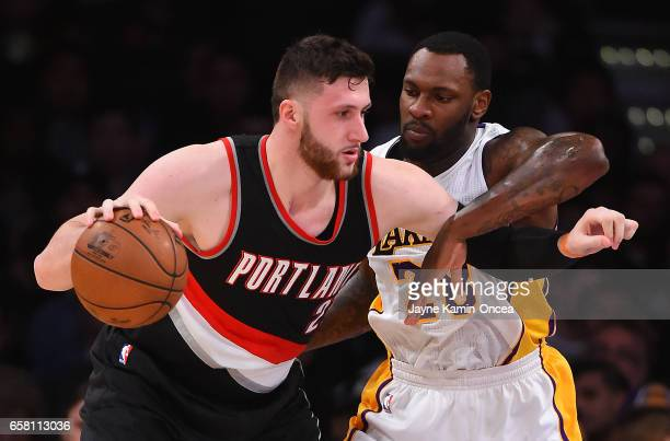 Tarik Black of the Los Angeles Lakers guards Jusuf Nurkic of the Portland Trail Blazers in the first half of the game at Staples Center on March 26...