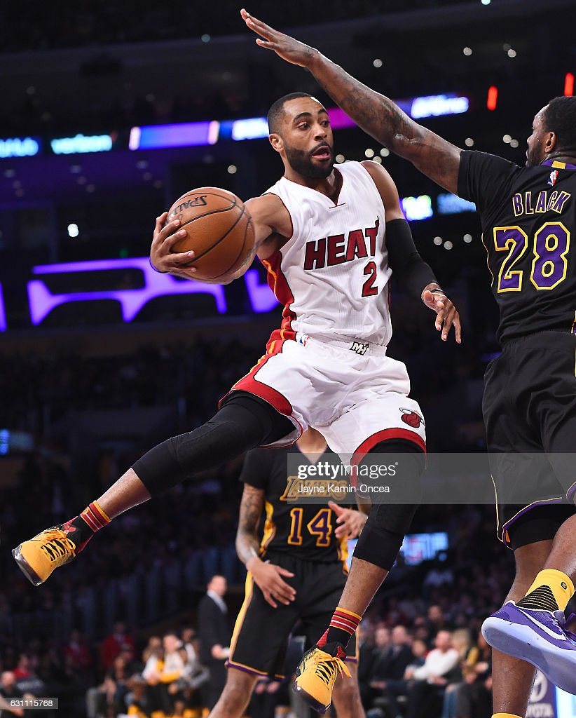 Tarik Black #28 of the Los Angeles Lakers reaches out to defend a pass by Wayne Ellington #2 of the Miami Heat in the first half of the game at Staples Center on January 6, 2017 in Los Angeles, California.