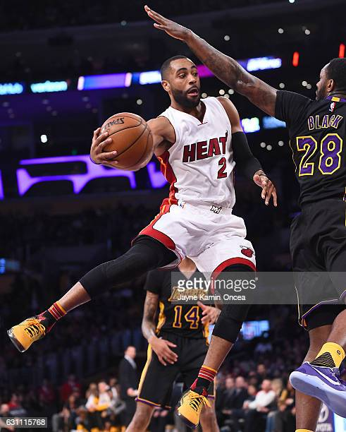 Tarik Black of the Los Angeles Lakers reaches out to defend a pass by Wayne Ellington of the Miami Heat in the first half of the game at Staples...