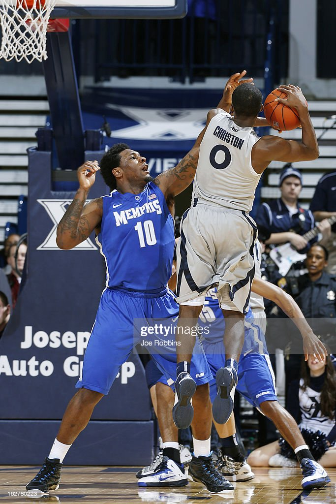 Tarik Black #10 of the Memphis Tigers defends against Semaj Christon #0 of the Xavier Musketeers during the game at Cintas Center on February 26, 2013 in Cincinnati, Ohio. Xavier defeated Memphis 64-62.