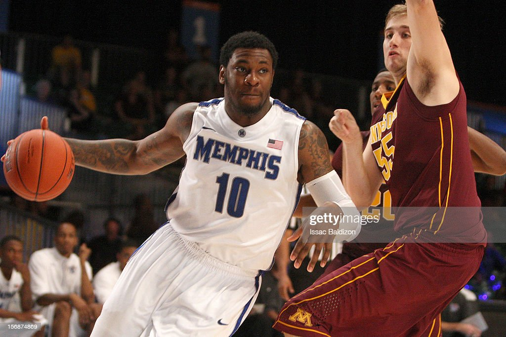 Tarik Black #10 of the Memphis Tigers drives against Elliot Eliason #55 of the Minnesota Gophers during the Battle 4 Atlantis tournament at Atlantis Resort November 23, 2012 in Nassau, Paradise Island, Bahamas.