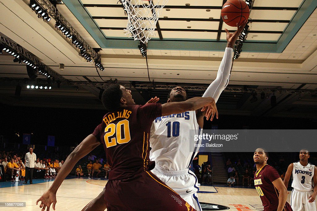 Tarik Black #10 of the Memphis Tigers shoots over Austin Hollins #20 of the Minnesota Gophers during the Battle 4 Atlantis tournament at Atlantis Resort November 23, 2012 in Nassau, Paradise Island, Bahamas.