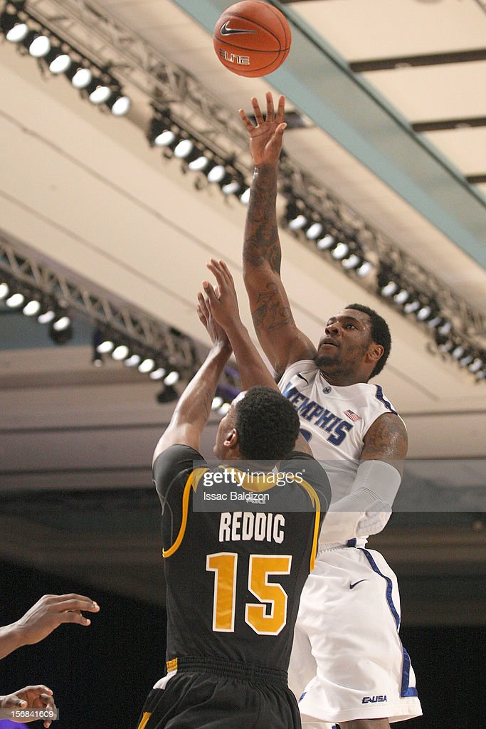 Tarik Black #10 of the Memphis Tigers shoots over Jarred Reddic #15 of the VCU Rams during the Battle 4 Atlantis tournament at Atlantis Resort on November 22, 2012 in Nassau, Paradise Island, Bahamas.