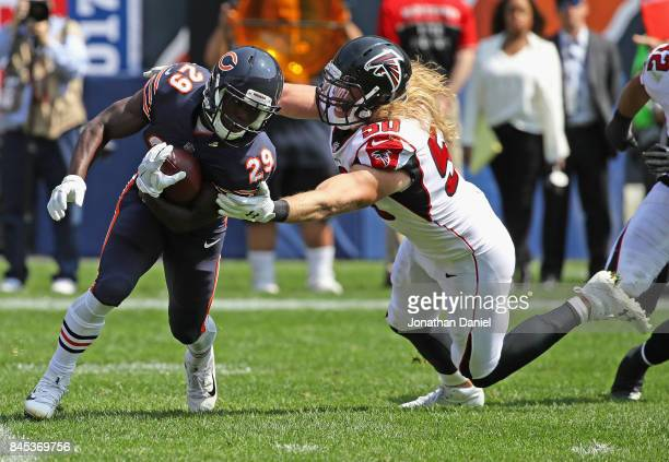 Tarik Cohen of the Chicago Bears avoids a tackle attempt by Brooks Reed of the Atlanta Falcons during the season opening game at Soldier Field on...