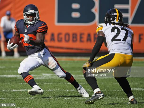 Tarik Cohen of the Chicago Bears breaks a long run in overtime against JJ Wilcox of the Pittsburgh Steelers at Soldier Field on September 24 2017 in...
