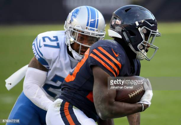 Tarik Cohen of the Chicago Bears carries the football against Glover Quin of the Detroit Lions in the third quarter at Soldier Field on November 19...