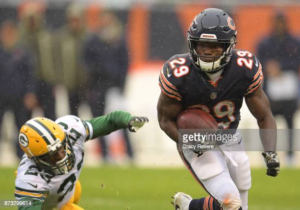 Tarik Cohen of the Chicago Bears carries the football against the Green Bay Packers in the second quarter at Soldier Field on November 12 2017 in...