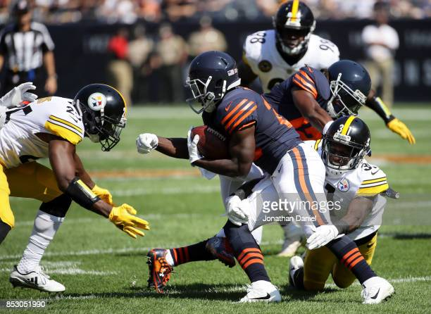 Tarik Cohen of the Chicago Bears carries the football in the first quarter against the Pittsburgh Steelers at Soldier Field on September 24 2017 in...