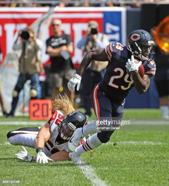 Tarik Cohen of the Chicago Bears eludes Brooks Reed of the Atlanta Falcons during the season opening game at Soldier Field on September 10 2017 in...