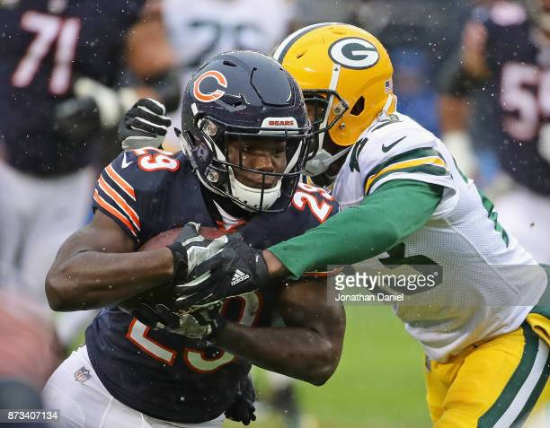 Tarik Cohen of the Chicago Bears is hit by Damarious Randall of the Green Bay Packers at Soldier Field on November 12 2017 in Chicago Illinois The...
