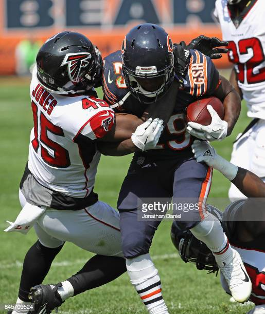 Tarik Cohen of the Chicago Bears is hit by Deion Jones of the Atlanta Falcons during the season opening game at Soldier Field on September 10 2017 in...