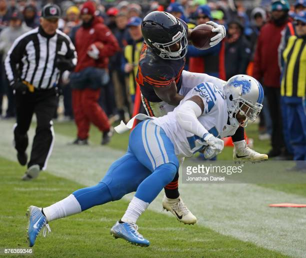 Tarik Cohen of the Chicago Bears is hit by Glover Quin of the Detroit Lions as he runs to the end zone at Soldier Field on November 19 2017 in...
