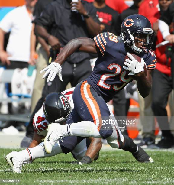 Tarik Cohen of the Chicago Bears moves around Duke Riley of the Atlanta Falcons during the season opening game at Soldier Field on September 10 2017...