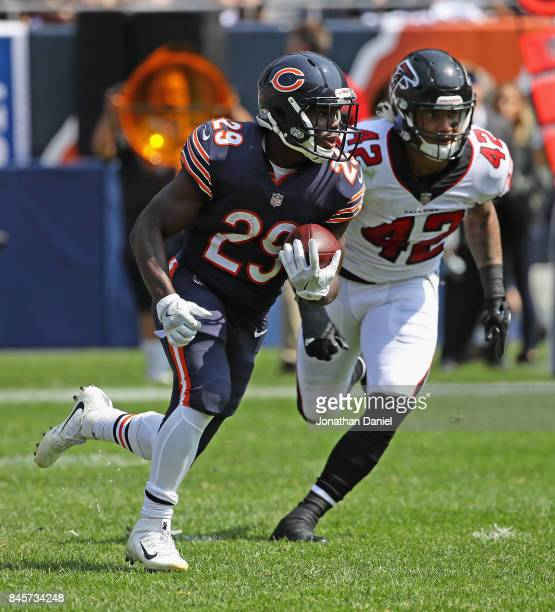 Tarik Cohen of the Chicago Bears moves past Duke Riley of the Atlanta Falcons during the season opening game at Soldier Field on September 10 2017 in...