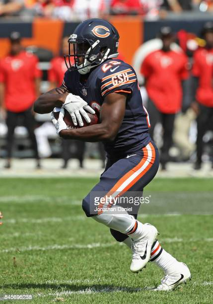 Tarik Cohen of the Chicago Bears runs against the Atlanta Falcons during the season opening game at Soldier Field on September 10 2017 in Chicago...