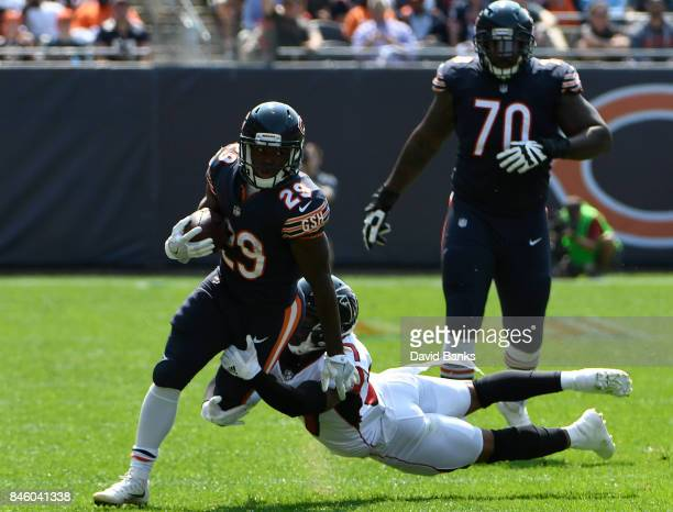 Tarik Cohen of the Chicago Bears runs against the Atlanta Falcons during the first quarter on September 10 2017 at Soldier Field in Chicago Illinois