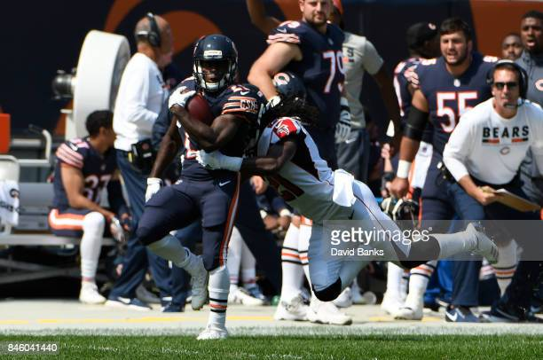 Tarik Cohen of the Chicago Bears runs against the Atlanta Falcons during the second quarter on September 10 2017 at Soldier Field in Chicago Illinois