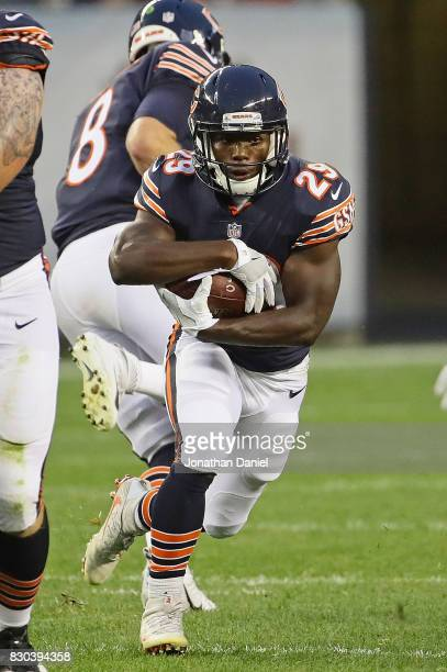 Tarik Cohen of the Chicago Bears runs against the Denver Broncos during a preseason game at Soldier Field on August 10 2017 in Chicago Illinois The...