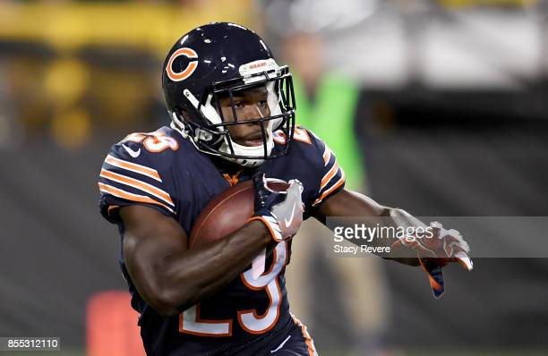 Tarik Cohen of the Chicago Bears runs with the ball in the first quarter against the Green Bay Packers at Lambeau Field on September 28 2017 in Green...