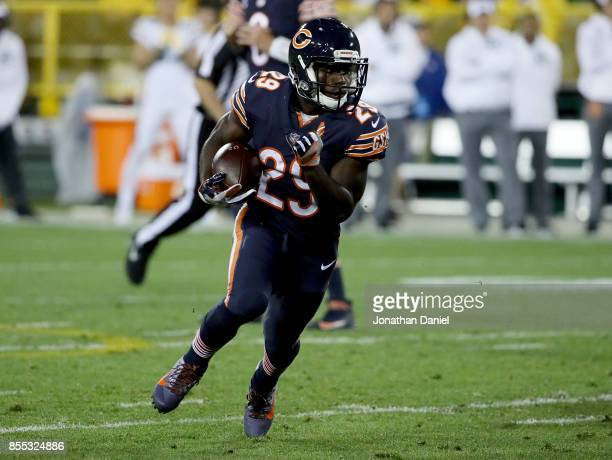 Tarik Cohen of the Chicago Bears runs with the ball in the second quarter against the Green Bay Packers at Lambeau Field on September 28 2017 in...