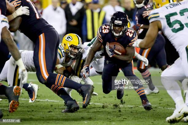 Tarik Cohen of the Chicago Bears runs with the ball in the third quarter against the Green Bay Packers at Lambeau Field on September 28 2017 in Green...