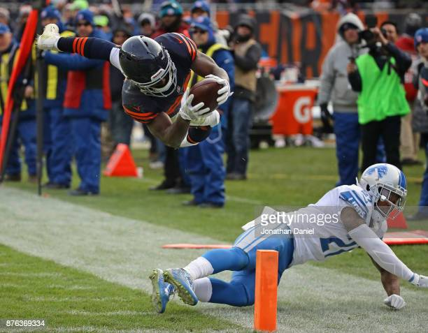 Tarik Cohen of the Chicago Bears sails across the goal line to score a touchdown after being hit by Glover Quin of the Detroit Lions at Soldier Field...