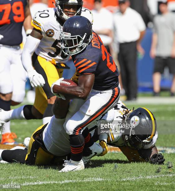 Tarik Cohen of the Chicago Bears tries to break a tackle by Bud Dupree and LT Walton of the Pittsburgh Steelers at Soldier Field on September 24 2017...