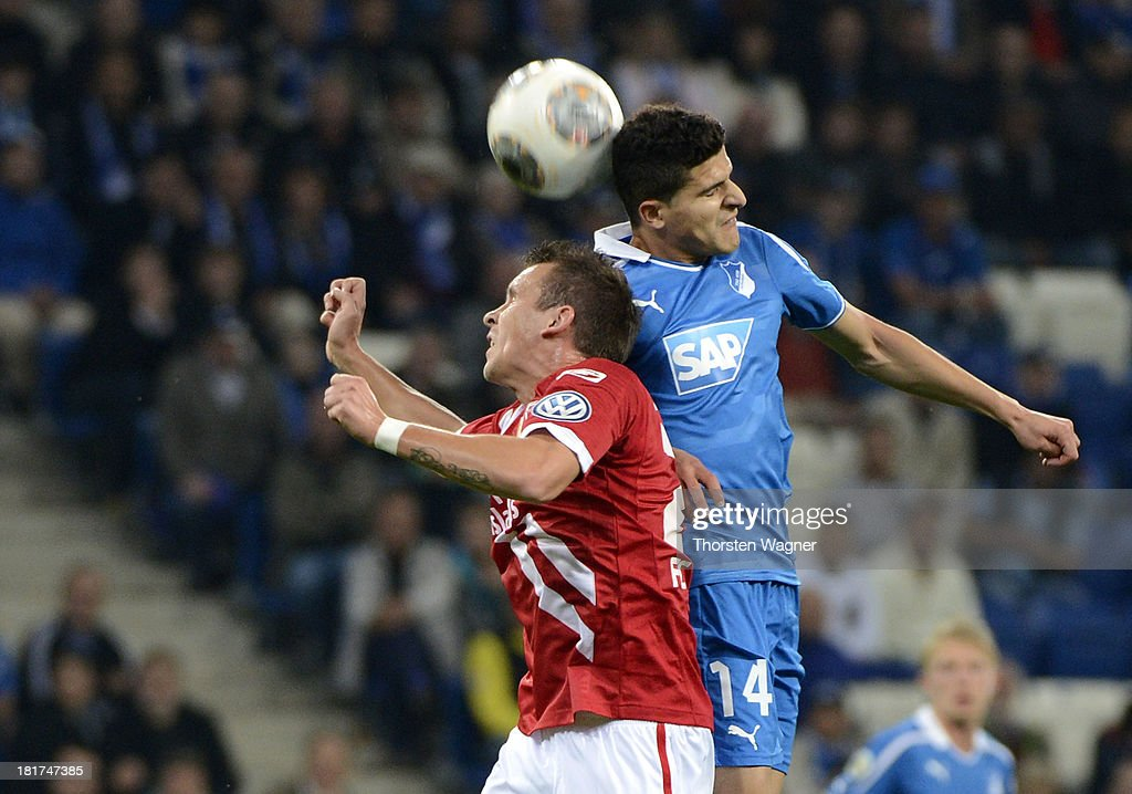 Tarik Elyounoussi (L) of Hoffenheim battles for the ball with Andre Fomitschow (L) of Cottbus during the DFB Cup second round match between TSG 1899 Hoffenheim and FC Energie Cottbus at Wirsol Rhein-Neckar-Arena on September 24, 2013 in Sinsheim, Germany.