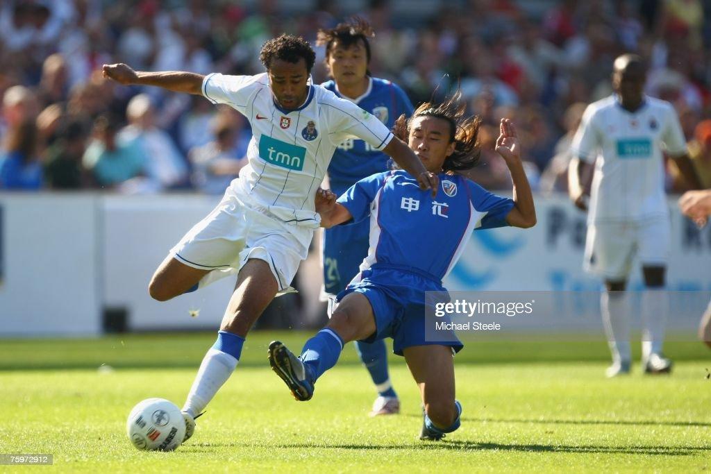 Tarik of Porto challenged by Xiao Zhan Bo during the Port of Rotterdam Tournament match between FC Porto and Shanghai Shenhua at the De Kuip Stadium...