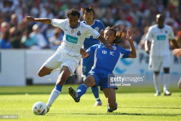 Tarik of Porto challenged by Xiao Zhan Bo during the Port of Rotterdam Tournament match between FC Porto and Shanghai Shenhua at the De Kuip Stadium...