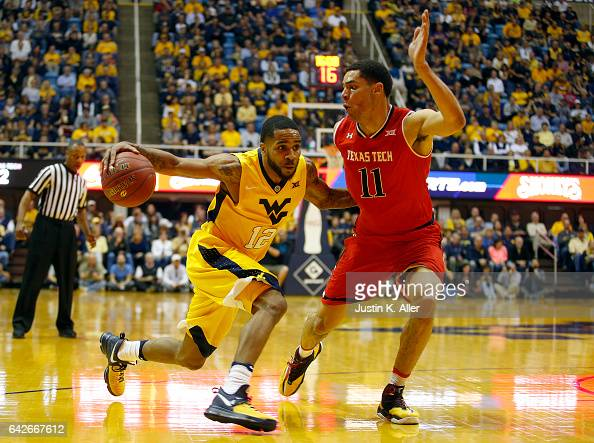 Tarik Phillip of the West Virginia Mountaineers drives against Zach Smith of the Texas Tech Red Raiders at the WVU Coliseum on February 18 2017 in...