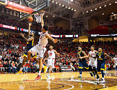 Tarik Phillip of the West Virginia Mountaineers shoots the ball and scores against Zach Smith of the Texas Tech Red Raiders during the game on...