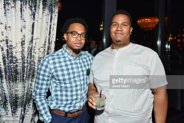 Tarik Watts and Omar Tucker attend The Junior Board of The TEAK Fellowship Presents A Midsummer Night at PhD Lounge at the Dream Downtown New York on...