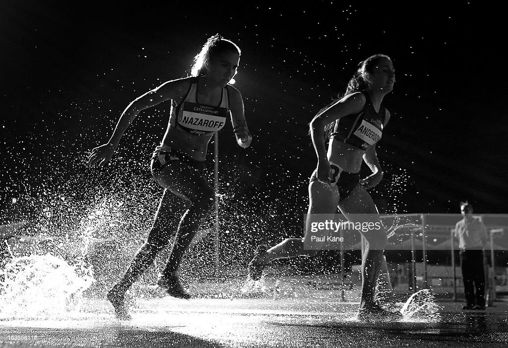 Tarinah Nazaroff of Western Australia and Chloe Anderson of Victoria compete in the Women's under 17 2000 metre steeplechase during day one of the Australian Junior Championships at the WA Athletics Stadium on March 12, 2013 in Perth, Australia.