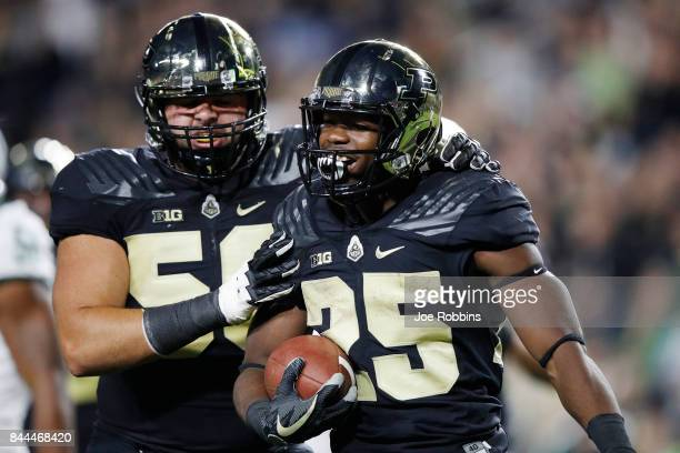 Tario Fuller of the Purdue Boilermakers celebrates after rushing for a touchdown in the second quarter of a game against the Ohio Bobcats at RossAde...