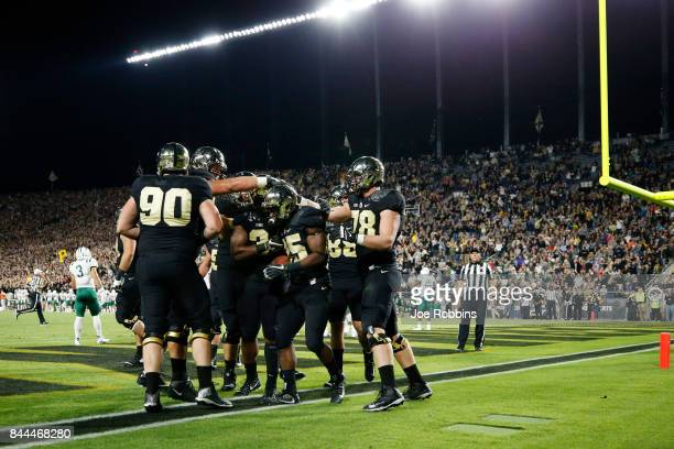 Tario Fuller of the Purdue Boilermakers celebrates with teammates after rushing for a touchdown in the second quarter of a game against the Ohio...