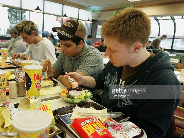 Tariq Dababneh and Matt Krueger sample a complimentary fruit cup and fruit bowl inside a Wendy's restaurant February 15 2005 in Glenview Illinois...