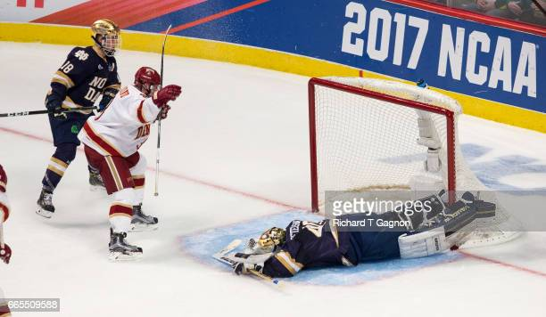Tariq Hammond of the Denver Pioneers celebrates his goal against Cal Petersen of the Notre Dame Fighting Irish during game two of the 2017 NCAA...
