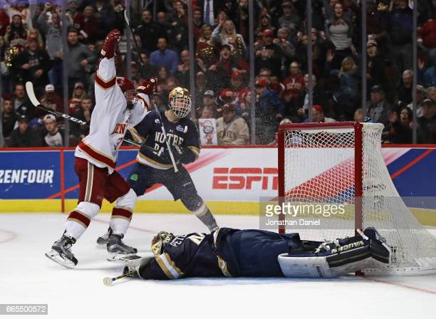 Tariq Hammond of the Denver Pioneers celebrates scoring a second period goal against Cal Petersen of the Notre Dame Fighting Irish during game two of...
