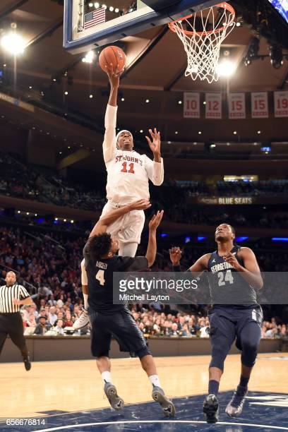 Tariq Owens of the St John's Red Storm drives to the basket during the Big East Basketball Tournament First Round game against the Georgetown Hoyas...