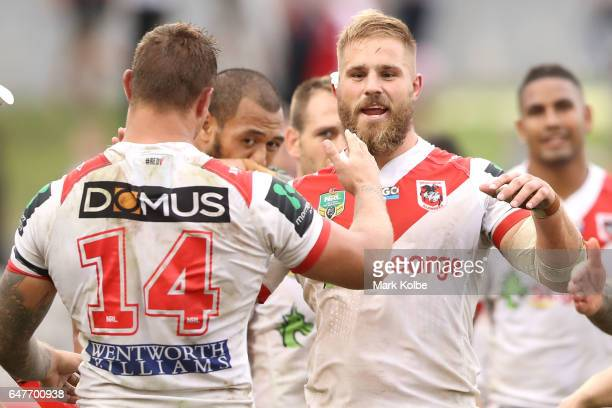 Tariq Sims and Jack de Belin of the Dragons celebrate victory during the round one NRL match between the St George Illawarra Dragons and the Penrith...