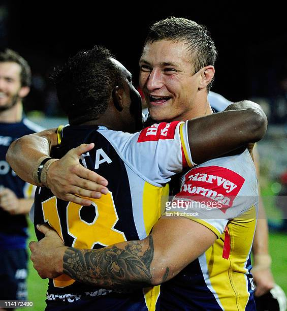 Tariq Sims and James Segeyaro of the Cowboys celebrate after winning the round 10 NRL match between the North Queensland Cowboys and the Parramatta...