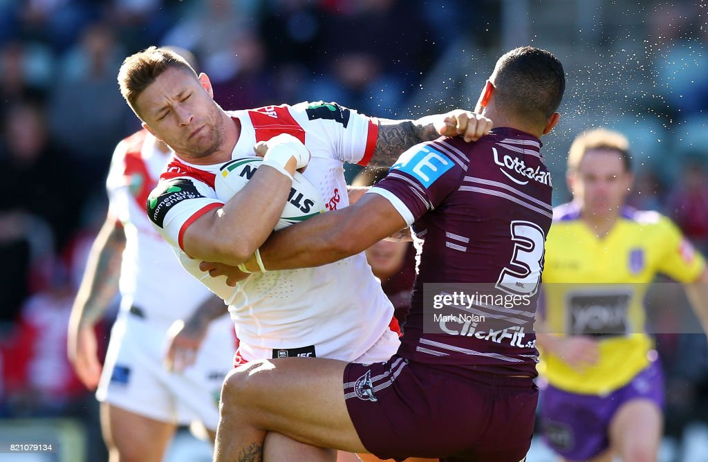 Tariq Sims of the Dragons is tackled by Dylan Walker of the Eagles during the round 20 NRL match between the St George Illawarra Dragons and the Manly Sea Eagles at WIN Stadium on July 23, 2017 in Wollongong, Australia.