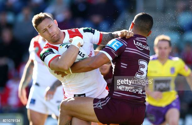 Tariq Sims of the Dragons is tackled by Dylan Walker of the Eagles during the round 20 NRL match between the St George Illawarra Dragons and the...