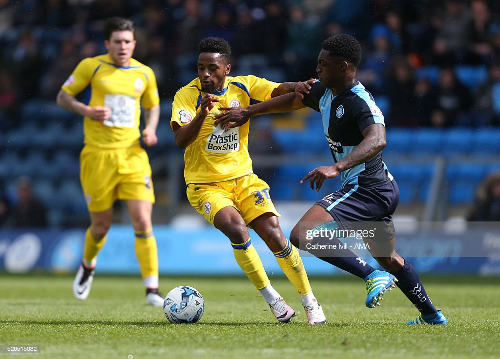 Tariqe Fosu of Accrington Stanley and Anthony Stewart of Wycombe Wanderers during the Sky Bet League Two match between Wycombe Wanderers and Accrington Stanley at Adams Park on April 30, 2016 in High Wycombe, England.