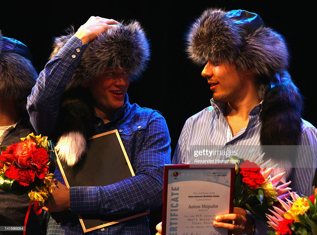 Tarjei Boe (L) of Norway smiles with Anton Shipulin of Russia during the IBU Awarding Ceremony at Ugra Classic concert hall on March 18, 2012 in Khanty-Mansiysk, Russia.