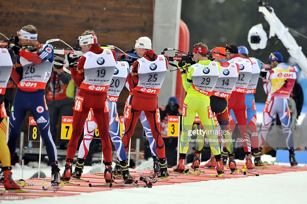 Tarjei Boe of Norway takes 1st place, Anton Shipulin of Russia takes 2nd place, Emil Hegle Svendsen of Norway takes 1st place Martin Fourcade of France during the IBU Biathlon World Championship Men's 15km Mass Start on February 17, 2013 in Nove Mesto, Czech Republic.