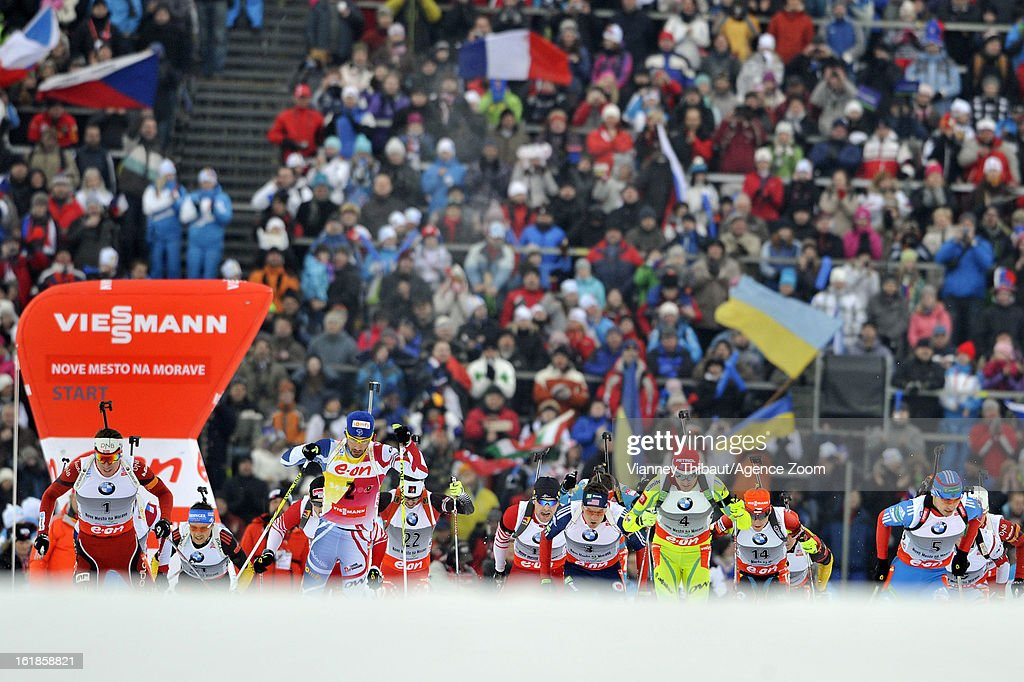 Tarjei Boe of Norway takes 1st place, Anton Shipulin of Russia takes 2nd place, Emil Hegle Svendsen of Norway takes 3rd place during the IBU Biathlon World Championship Men's 15km Mass Start on February 17, 2013 in Nove Mesto, Czech Republic.
